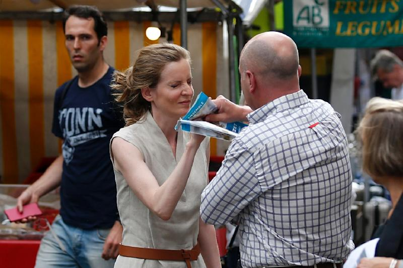 A passerby, who has been identified as Vincent Debraize, mayor of Champignolles, takes leaflets from the hand of Les Republicains (LR) party candidate Nathalie Kosciusko-Morizet during an altercation while campaigning in Paris on June 15, 2017