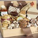 """<p>oliveandcocoa.com</p><p><strong>$50.00</strong></p><p><a href=""""https://www.oliveandcocoa.com/product/snacks-to-share/top-10-food-gifts"""" rel=""""nofollow noopener"""" target=""""_blank"""" data-ylk=""""slk:Shop Now"""" class=""""link rapid-noclick-resp"""">Shop Now</a></p><p>'Tis the season for sharing! This snack box is brimming with delectable bites, including white chocolate gummy bears, trail mix, rocky road popcorn, rustic crackers, and hummus.</p>"""