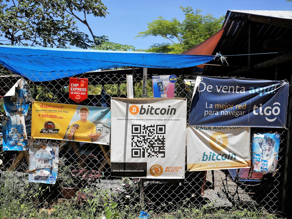 Bitcoin banners are seen outside of a small restaurant at El Zonte Beach in Chiltiupan, El Salvador 8 June, 2021 (Reuters)