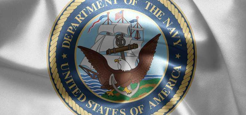 Department of the Navy crest on a shirt.