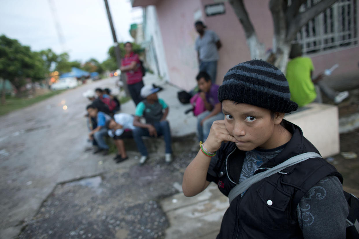 A 14-year-old Guatemalan girl traveling alone waits for a northbound freight train with other Central American migrants, in Arriaga, Chiapas state, Mexico, in June 2014. (Photo: Rebecca Blackwell/AP)