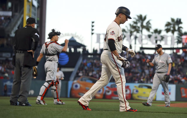 Hume plate umpire Andy Fletcher, left, ejects Miami Marlins pitcher Dan Straily, right, after Straily hit San Francisco Giants' Buster Posey, foreground, with a pitch during the second inning of a baseball game Tuesday, June 19, 2018, in San Francisco. (AP Photo/Ben Margot)
