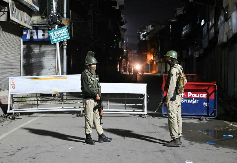Dozens of paramilitary troops in combat gear and armed with rifles were deployed in a central part of Srinagar (AFP Photo/Tauseef MUSTAFA)