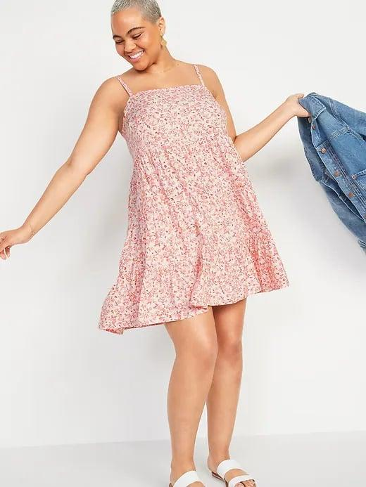 <p>Grab your denim jacket and your favorite pattern of this <span>Old Navy Printed Sleeveless Tiered Swing Dress</span> ($24-$28, originally $35) for a warm spring night out.</p>