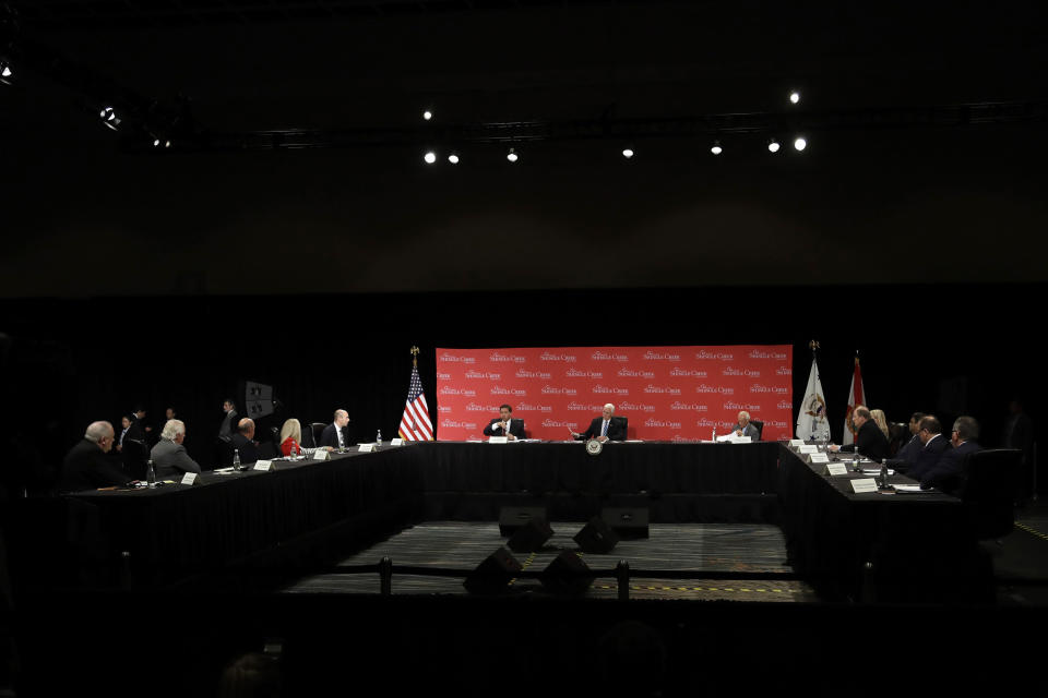 Vice President Mike Pence, center, participates in a roundtable discussion Wednesday, May 20, 2020, in Orlando, Fla. The roundtable was held with hospitality and tourism industry leaders to discuss their plans for re-opening during the coronavirus outbreak. (AP Photo/Chris O'Meara)