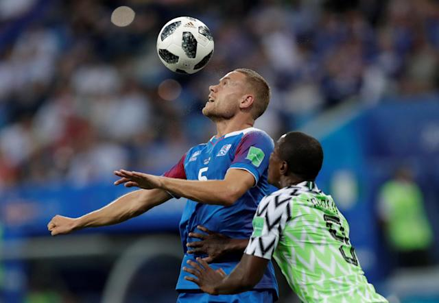 Soccer Football - World Cup - Group D - Nigeria vs Iceland - Volgograd Arena, Volgograd, Russia - June 22, 2018 Iceland's Sverrir Ingi Ingason in action with Nigeria's Odion Ighalo REUTERS/Ueslei Marcelino TPX IMAGES OF THE DAY