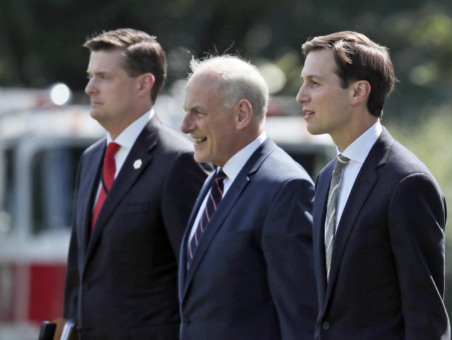 White House staff secretary Rob Porter, White House chief of staff John Kelly, and White House senior adviser Jared Kushner walk to Marine One. (Photo: Alex Brandon)