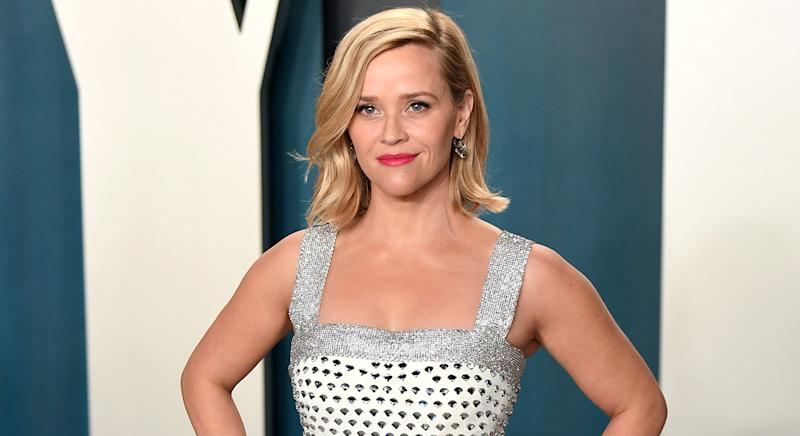 Reese Witherspoon has proved she has a penchant for red lipstick as she wore the statement look at the Vanity Fair awards in February 2020, and again for this year's Emmy Awards. (Getty Images)