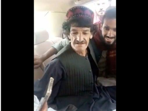 A screengrab from the video that shows comic  Nazar Mohammad, better known as Khasha Zwan getting thrashed by Taliban men (Screengrab/Videio)