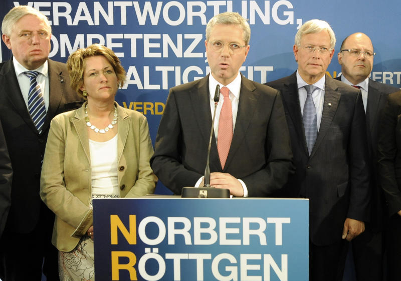 Norbert Roettgen, top candidate of the Christian Democratic Union party CDU for the North-Rhine Westphalian federal state elections, center, reacts disappopinted with his wife Ebba, left, and party board members after the first projections after the polls in Duesseldorf, Germany, Sunday, May 13, 2012. Chancellor Merkel's CDU party faces biggest losses at Germany's most important and populous federal state elections. (AP Photo/Martin Meissner)