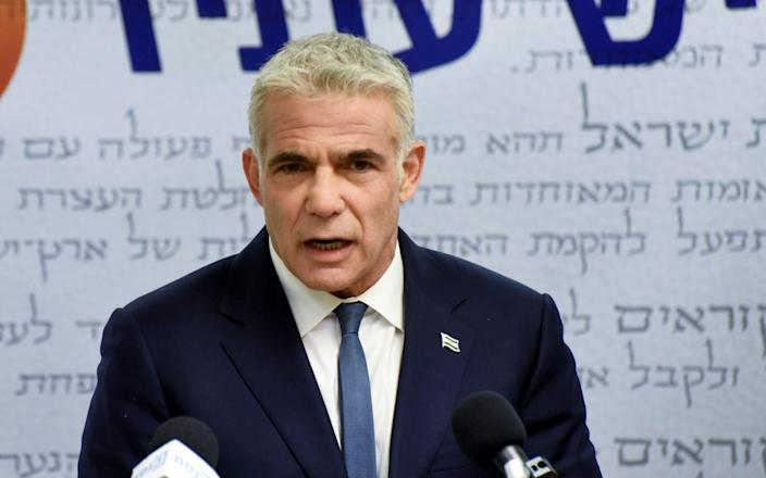 Yair Lapid, head of the centrist Yesh Atid party, delivers a statement to the press before the party faction meeting at the Knesset, Israel's parliament - Reuters/Debbie Hill/Reuters/Debbie Hill