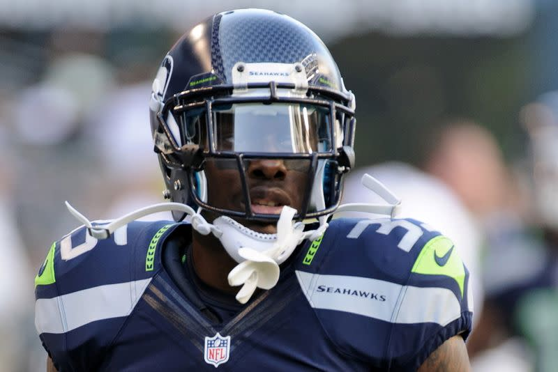 Seattle Seahawks defensive back Phillip Adams warms up prior to the NFL game against the Tennessee Titans