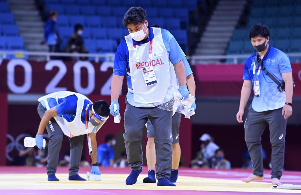 <p>Disinfection against COVID-19 by medical staff during the Tokyo 2020 Summer Olympic Games on July 25, 2021 in Tokyo, Japan, 25/07/2021 ( Photo by Vincent Kalut / Photonews via Getty Images)</p>