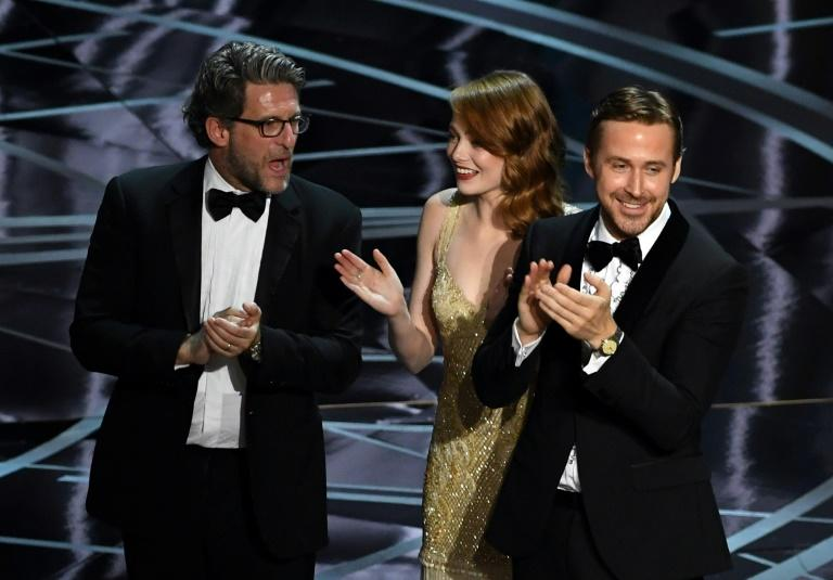 (L-R) Producer Gary Gilbert, actors Emma Stone and Ryan Gosling celebrate 'La La Land' winning Best Picture due to a presentation error onstage during the 89th Annual Academy Awards on February 26, 2017