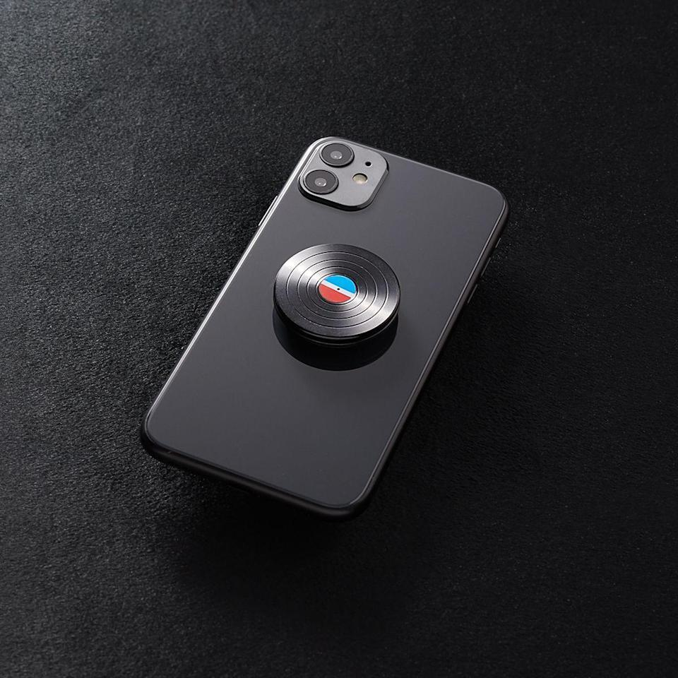 """<p><strong>PopSockets</strong></p><p>popsockets.com</p><p><strong>$20.00</strong></p><p><a href=""""https://go.redirectingat.com?id=74968X1596630&url=https%3A%2F%2Fwww.popsockets.com%2Fp%2Fbackspin-aluminum-45-rpm%2FQRX-CMF-Backspin-Aluminum-45-RPM.html%3Flang%3Den_US&sref=https%3A%2F%2Fwww.seventeen.com%2Flove%2Fdating-advice%2Fg30107520%2Fone-year-anniversary-gifts-for-him-boyfriend%2F"""" rel=""""nofollow noopener"""" target=""""_blank"""" data-ylk=""""slk:Shop Now"""" class=""""link rapid-noclick-resp"""">Shop Now</a></p><p>This vinyl phone holder is so much cooler than your average PopGrip (but will still stop him from dropping his phone every two seconds).</p>"""
