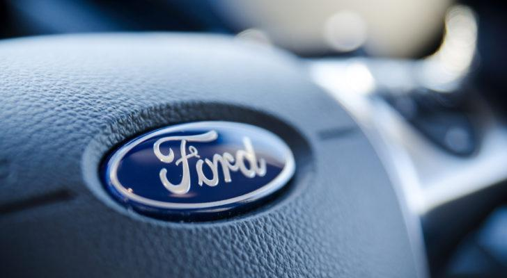 Ford (F) logo on a steering wheel.
