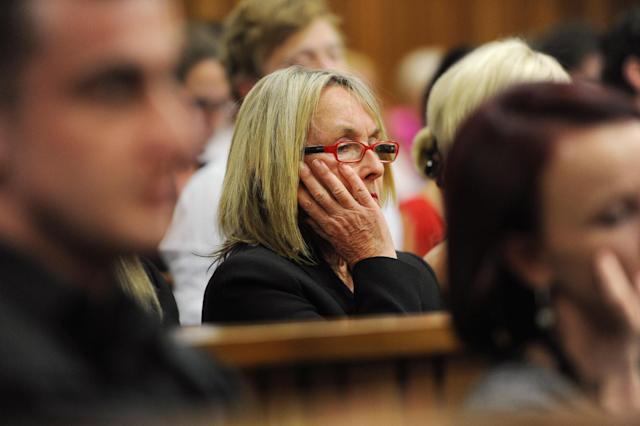 June Steenkamp, mother of the late Reeva Steenkamp, listens as state prosecutor Gerrie Nel questions Oscar Pistorius, in court in Pretoria, South Africa, Thursday, April 10, 2014. Pistorius is charged with the murder of his girlfriend Steenkamp, on Valentines Day in 2013. (AP Photo/Werner Beukes, Pool)