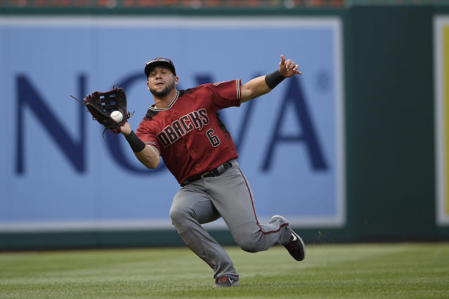 Arizona Diamondbacks left fielder David Peralta (6) catches a fly ball by Washington Nationals' Anthony Rendon for the out during the third inning of a baseball game, Saturday, June 15, 2019, in Washington. (AP Photo/Nick Wass)