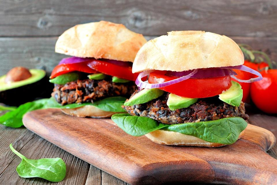 """<p>Burgers are some of <a href=""""https://www.thedailymeal.com/cook/most-searched-coronavirus-recipes?referrer=yahoo&category=beauty_food&include_utm=1&utm_medium=referral&utm_source=yahoo&utm_campaign=feed"""" rel=""""nofollow noopener"""" target=""""_blank"""" data-ylk=""""slk:the most-searched-for recipes online"""" class=""""link rapid-noclick-resp"""">the most-searched-for recipes online</a>, but if you're trying to cut out red meat, these black bean burgers are a great option.</p> <p><a href=""""https://www.thedailymeal.com/recipes/black-bean-burger-recipe-recipe?referrer=yahoo&category=beauty_food&include_utm=1&utm_medium=referral&utm_source=yahoo&utm_campaign=feed"""" rel=""""nofollow noopener"""" target=""""_blank"""" data-ylk=""""slk:For the Black Bean Burger recipe, click here."""" class=""""link rapid-noclick-resp"""">For the Black Bean Burger recipe, click here.</a></p>"""