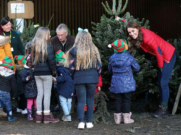 PHOTO: Children gather to help Britain's Kate the Duchess of Cambridge to pick a Christmas Tree, as she takes part in Christmas activities in Buckinghamshire, England, Dec. 4, 2019. (onathan Brady/PA via AP)
