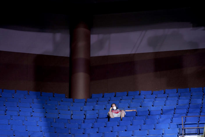 Image: A supporter sits in the stands at a campaign rally for President Donald Trump in Tulsa, Okla., on June 20, 2020. (Evan Vucci / AP)
