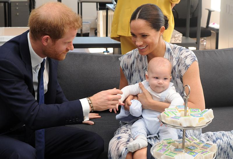 Britain's Duke and Duchess of Sussex, Prince Harry and his wife Meghan hold their baby son Archie as they meet with Archbishop Desmond Tutu (unseen) at the Tutu Legacy Foundation in Cape Town on September 25, 2019. - The British royal couple are on a 10-day tour of southern Africa -- their first official visit as a family since their son Archie was born in May. (Photo by HENK KRUGER / POOL / AFP) (Photo credit should read HENK KRUGER/AFP/Getty Images)
