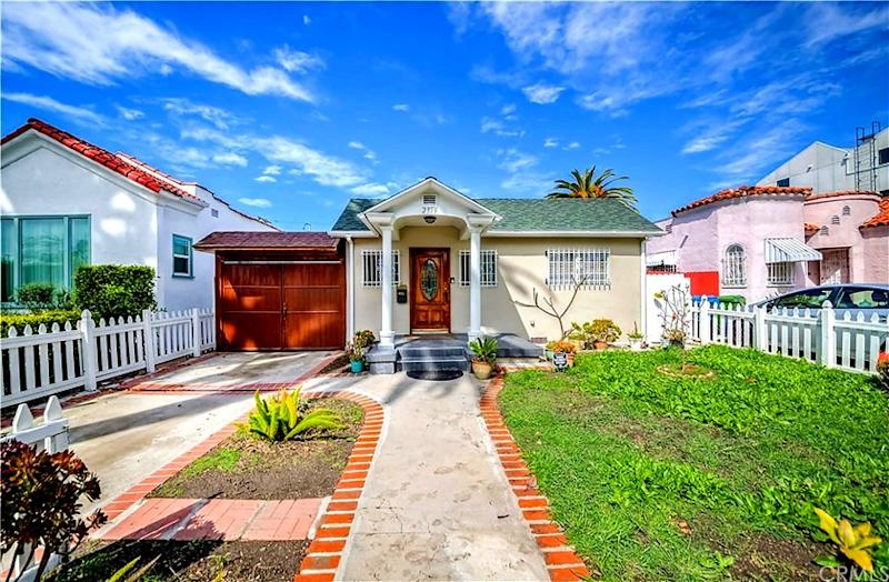 MID-CITY: A white picket fence and landscaped yard draw the eye outside this three-bed, two-bath home near the 110 Freeway. Address: 2319 S. Cloverdale Ave., Los Angeles, 90016 Listed for: $875,000 for three bedrooms, two bathrooms in 1,416 square feet (5,040-square-foot lot) Features: Tile floors; arched doorways; upgraded kitchen; carport