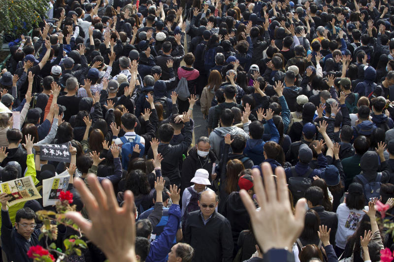 Participants raise their hands to show five demands during a rally demanding electoral democracy and call for boycott of the Chinese Communist Party and all businesses seen to support it in Hong Kong, Sunday, Jan. 19, 2020. Hong Kong has been wracked by often violent anti-government protests since June, although they have diminished considerably in scale following a landslide win by opposition candidates in races for district councilors late last year. (AP Photo/Ng Han Guan)