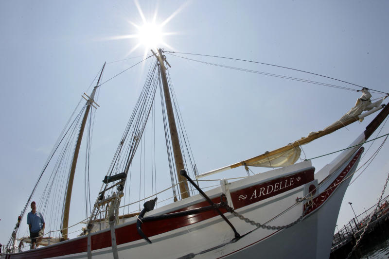 Shipwright Harold Burnham, 45, aboard the Ardelle while docked in Gloucester, Mass. Friday, June 22, 2012. Burnham is a master of a dying art. He builds schooners using hand tools and locally harvested wood, just as his family did 300 years ago. (AP Photo/Elise Amendola)