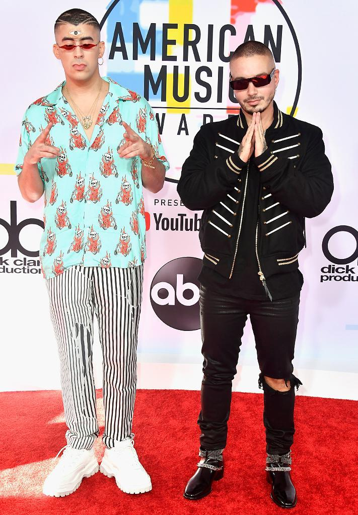 <p>Bad Bunny (L) and J Balvin attend the 2018 American Music Awards at Microsoft Theater on Oct. 9, 2018, in Los Angeles. (Photo: Frazer Harrison/Getty Images) </p>