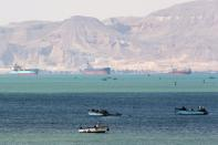 Ships are seen at the entrance of Suez Canal, which was blocked by stranded container ship Ever Given that ran aground