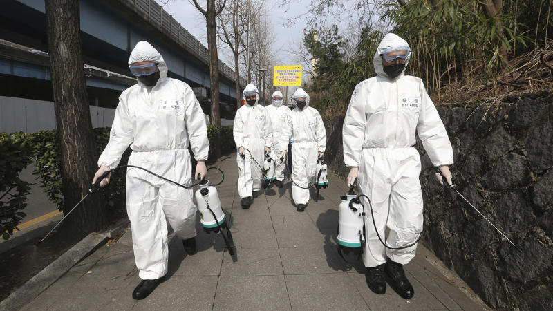 South Korean army soldiers spray disinfectant as a precaution against a new coronavirus on a street in Seoul, South Korea, Monday, March 9, 2020. (Ahn Young-joon/AP)