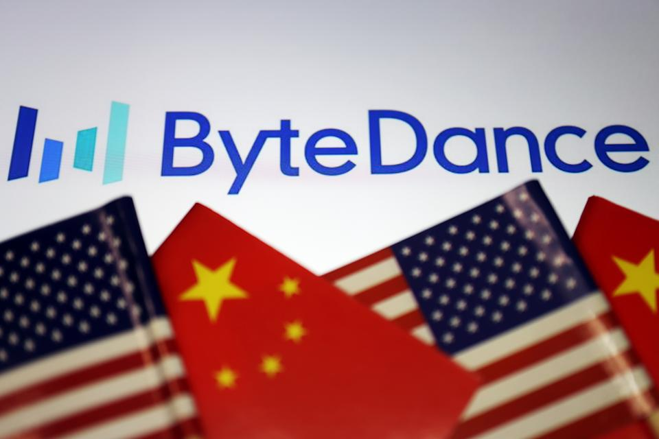 Flags of China and U.S. are seen near a Bytedance logo in this illustration picture taken September 18, 2020. REUTERS/Florence Lo/Illustration