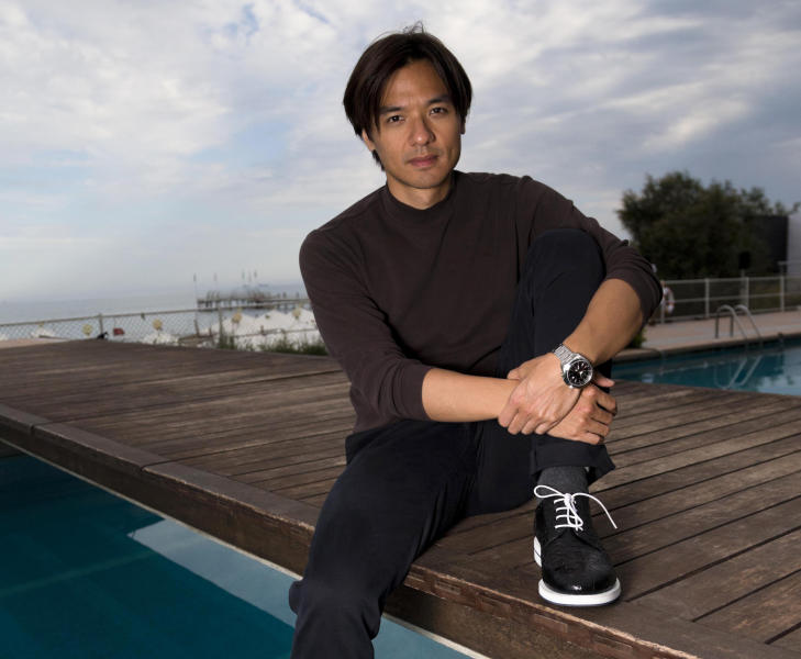 FILE- Director Stephen Fung poses for portraits for the film 'Tai Chi 0' at the 69th edition of the Venice Film Festival in Venice, Italy, in this file photo dated Thursday, Aug. 30, 2012. Fung has incorporated comic book-style graphic and heavy metal music into his movie ''Tai Chi 0,'' as he reaches for a younger and perhaps global audience in his new martial arts film, the first installment of a trilogy. (AP Photo/Domenico Stinellis, File)