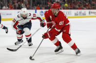 Detroit Red Wings center Frans Nielsen (81) controls the puck next to Washington Capitals defenseman Radko Gudas (33) during the second period of an NHL hockey game Saturday, Nov. 30, 2019, in Detroit. (AP Photo/Carlos Osorio)