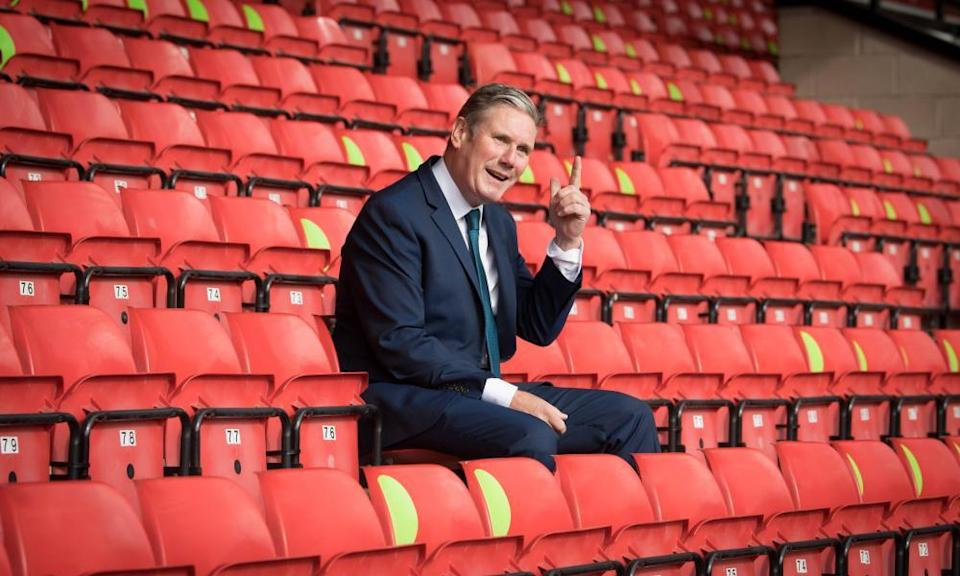 Keir Starmer, 'a football fan who supports Arsenal and England', at Walsall last September.
