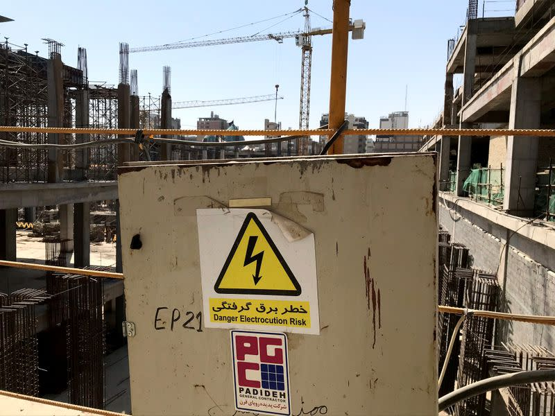 A warning sign in Persian with the company logo of Iranian engineering firm Padideh is seen next to the vast Sahn al-Aqila expansion project near Imam Hussein shrine in Kerbala