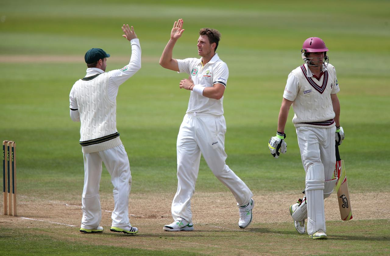 Somerset's Chris Jones shows his dejection after he was trapped LBW by Australian's James Pattinson (centre) during the International Tour match at the County Ground, Taunton.