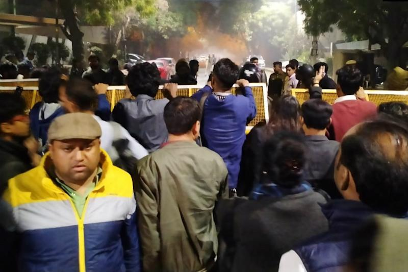 Police Use Water Cannons to Disperse Protesters at Kejriwal's Residence Seeking Action Against Rioters