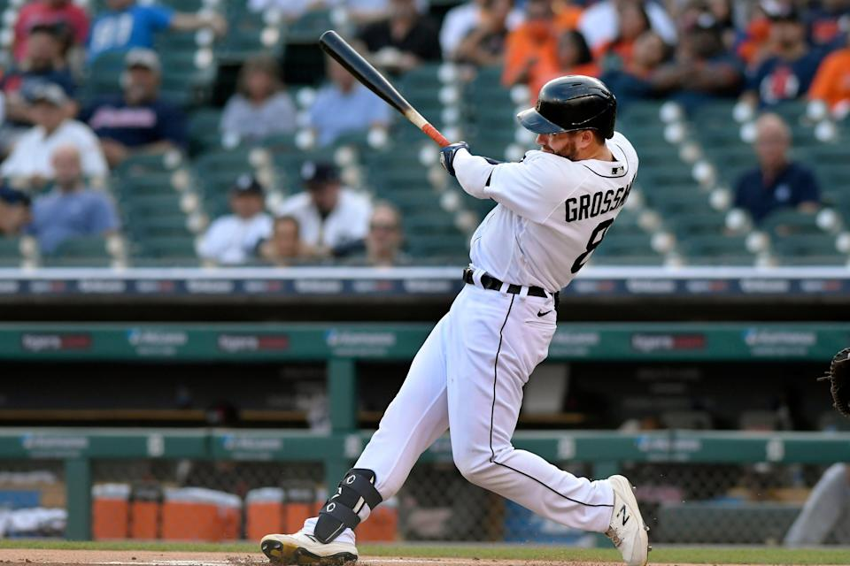 Tigers right fielder Robbie Grossman hits a double off Cleveland pitcher Zach Plesac in the first inning on Friday, Aug. 13, 2021, at Comerica Park.