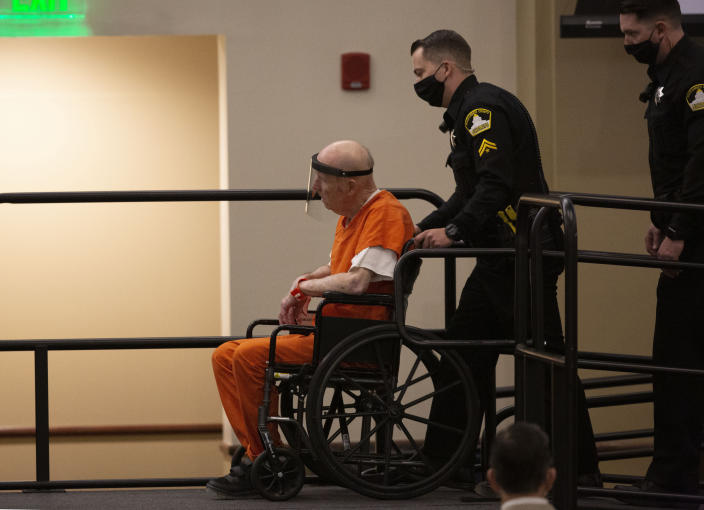 Joseph James DeAngelo, charged with being the Golden State Killer, is wheeled into the courtroom in Sacramento, Calif., Monday, June 29, 2020. DeAngelo, 74, pleaded guilty to multiple counts of murder and other charges 40 years after a sadistic series of assaults and slayings in California. Due to the large numbers of people attending, the hearing was held at a ballroom at California State University, Sacramento to allow for social distancing. (AP Photo/Rich Pedroncelli)