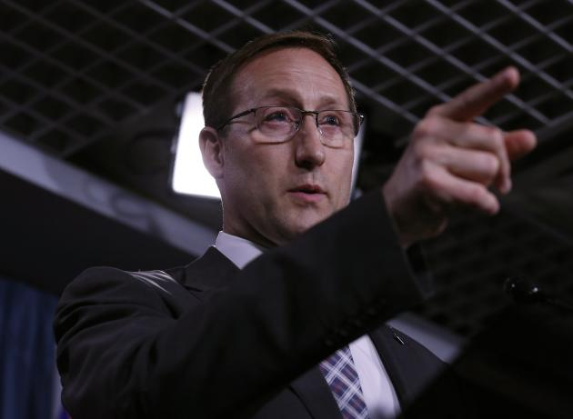 Justice Minister Peter MacKay speaks during a news conference on Parliament Hill.