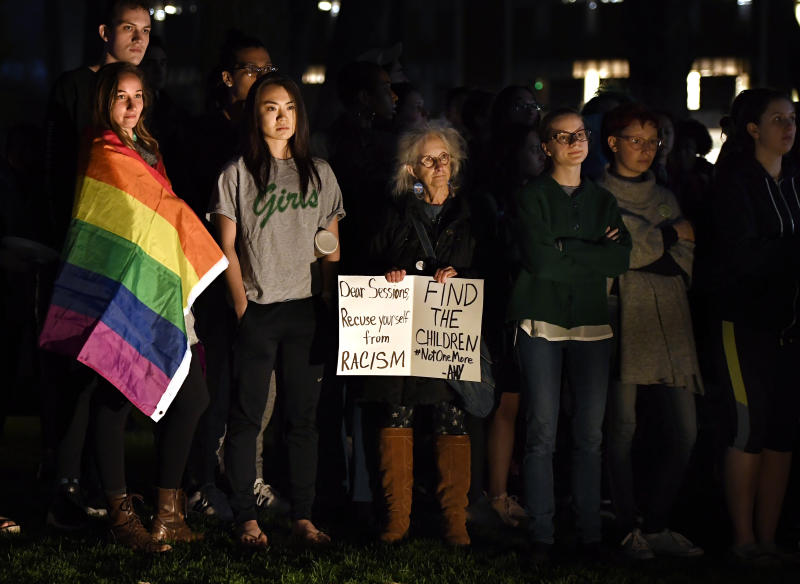 Protesters gather on a green near Johnson Chapel, where former attorney general Jeff Sessions is speaking, at Amherst College in Amherst, Mass., Wednesday, April 24, 2019. (AP Photo/Jessica Hill)