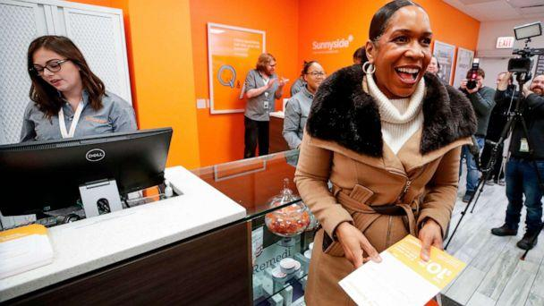 PHOTO: Lieutenant Governor of Illinois Juliana Stratton smiles after making a purchase at Sunnyside Cannabis Dispensary on Jan. 1, 2020, in Chicago. (Kamil Krzaczynski/AFP via Getty Images)
