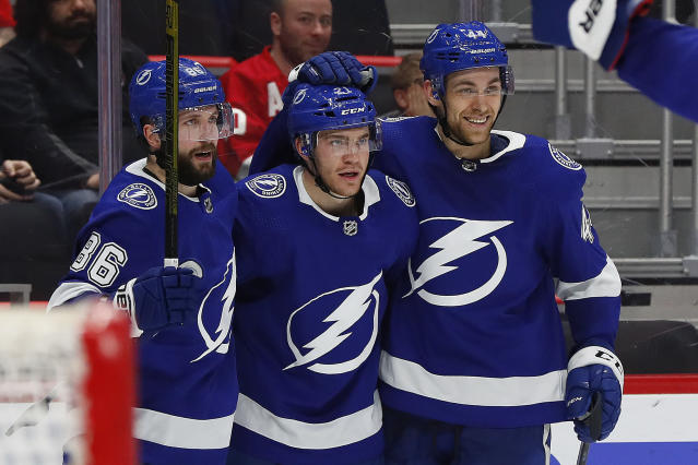 Tampa Bay Lightning center Brayden Point, center, celebrates his goal with Nikita Kucherov (86) and Tampa Bay Lightning defenseman Jan Rutta, right, in the third period of an NHL hockey game against the Detroit Red Wings, Thursday, March 14, 2019, in Detroit. (AP Photo/Paul Sancya)