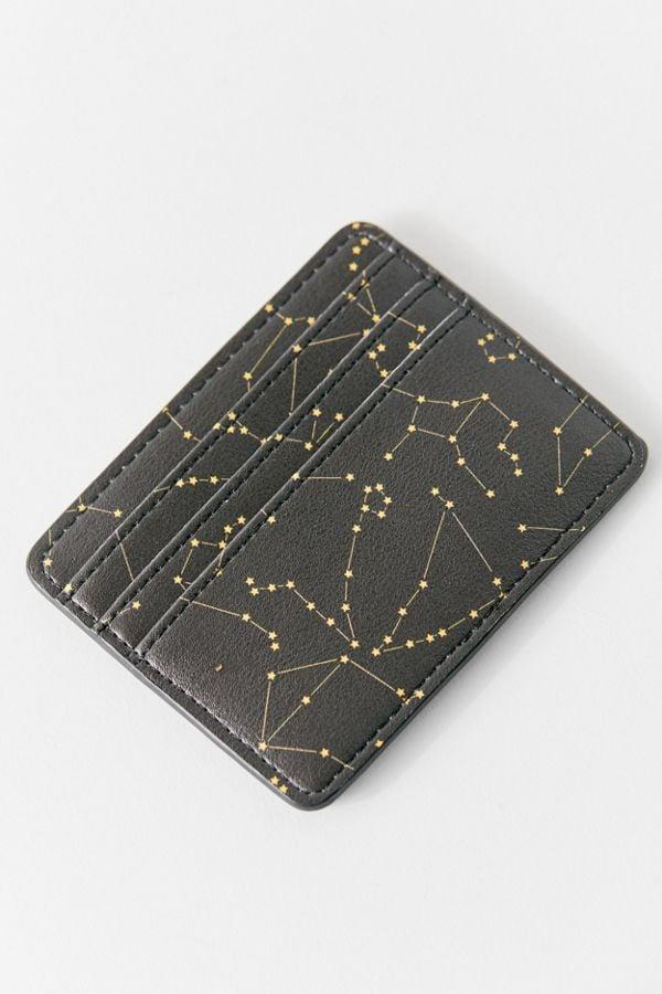 """<p>This <a href=""""https://www.popsugar.com/buy/Zodiac-Card-Case-522564?p_name=Zodiac%20Card%20Case&retailer=urbanoutfitters.com&pid=522564&price=9&evar1=tres%3Aus&evar9=45496944&evar98=https%3A%2F%2Fwww.popsugar.com%2Flove%2Fphoto-gallery%2F45496944%2Fimage%2F46937403%2FZodiac-Card-Case&list1=shopping%2Cgifts%2Choliday%2Cstocking%20stuffers%2Cgift%20guide%2Cgifts%20for%20women%2Cgifts%20for%20men%2Cgifts%20under%20%24100%2Cgifts%20for%20teens&prop13=api&pdata=1"""" rel=""""nofollow"""" data-shoppable-link=""""1"""" target=""""_blank"""" class=""""ga-track"""" data-ga-category=""""Related"""" data-ga-label=""""https://www.urbanoutfitters.com/shop/zodiac-card-case?category=stocking-stuffers&amp;color=001&amp;type=REGULAR"""" data-ga-action=""""In-Line Links"""">Zodiac Card Case</a> ($9) is something that everyone will want to have. It's so useful and cute!</p>"""