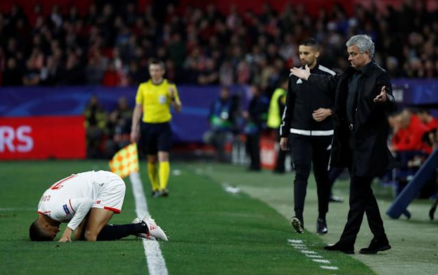 Soccer Football - Champions League Round of 16 First Leg - Sevilla vs Manchester United - Ramon Sanchez Pizjuan, Seville, Spain - February 21, 2018 Manchester United manager Jose Mourinho reacts as Sevilla's Joaquin Correa kneels on the pitch REUTERS/Juan Medina