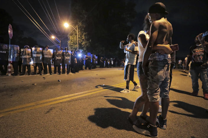 A man identified as Sonny Webber, right, father of Brandon Webber who was reportedly shot by U.S. Marshals earlier in the evening, joins a standoff as protesters take to the streets of the Frayser community in anger against the shooting, Wednesday, June 12, 2019, in Memphis, Tenn. (Photo: Jim Weber/Daily Memphian via AP)