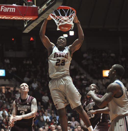Mississippi's Reginald Buckner (23) dunks against Mississippi State's Colin Borchert (3) and Gavin Ware (20) during an NCAA college basketball game Wednesday, Feb. 6, 2013, in Oxford, Miss. Mississippi won 93-75. (AP Photo/Oxford Eagle, Bruce Newman)