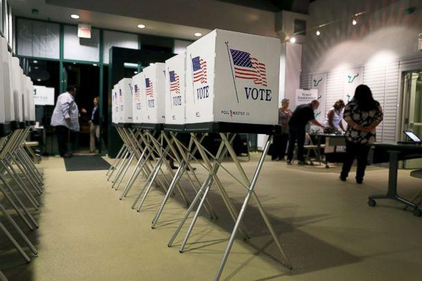 PHOTO: Voting booths are setup at the Yuengling center on the campus of University of South Florida as workers prepare to open the doors to early voters, Oct. 22, 2018, in Tampa, Fla. (Joe Raedle/Getty Images)